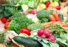 Fresh organic vegetables - closeup. Fresh  organic vegetables in wicker basket on table - closeup Royalty Free Stock Photography