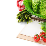 Fresh organic vegetables and cooking book Royalty Free Stock Images
