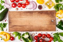 Fresh Organic Vegetables and cutting board with place for text. Healthy food or diet concept.  royalty free stock photography