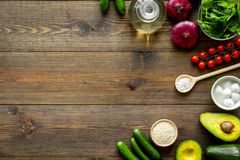Fresh organic vegetables on dark wooden background top view copy space. Kitchen desk for preparing salad royalty free stock photo