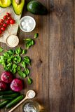 Fresh organic vegetables on dark wooden background top view copy space. Kitchen desk for preparing salad stock image