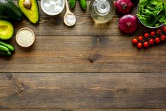 Fresh organic vegetables on dark wooden background top view copy space. Kitchen desk for preparing salad stock photo