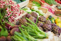 Fresh organic vegetables and fruits on farmer market in Paris, France. Typical European market of home grown produce Stock Photos