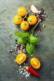 Fresh organic vegetables on rustic background Stock Photo