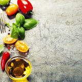 Fresh organic vegetables on rustic background Stock Photos