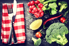 Fresh organic vegetables and rustic cutlery. Healthy cooking con Royalty Free Stock Images