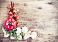 Fresh Organic Vegetables and Spices on a Wooden Background Royalty Free Stock Images