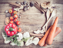 Fresh Organic Vegetables and Spices on a Wooden Background. Royalty Free Stock Image