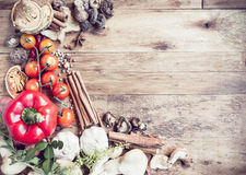 Fresh Organic Vegetables and Spices on a Wooden Background. Stock Photo