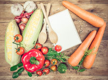 Fresh Organic Vegetables and Spices on a Wooden Background Royalty Free Stock Photos