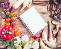 Fresh Organic Vegetables and Spices on a Wooden Background Stock Photos