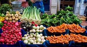 Fresh Organic Vegetables At A Street Market. Fresh Organic Lemon, spinach, celery root, Lettuce, beet, radish, turnip, Mint, Carrot, and Leek At A Street Market Royalty Free Stock Photo