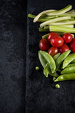 Fresh organic vegetables and vibrant dip selection Royalty Free Stock Photo