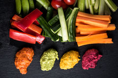 Fresh organic vegetables and vibrant dip selection Royalty Free Stock Image