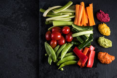 Fresh organic vegetables and vibrant dip selection Stock Image