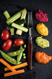 Fresh organic vegetables and vibrant dip selection Royalty Free Stock Photos