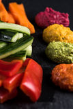 Fresh organic vegetables and vibrant dip selection Stock Photography