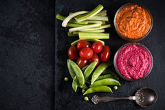 Fresh organic vegetables and vibrant dip selection Royalty Free Stock Photography