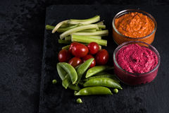 Fresh organic vegetables and vibrant dip selection Stock Photos