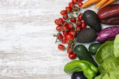 Fresh organic vegetables on white wood background. Healthy natural food on table with copy space royalty free stock image