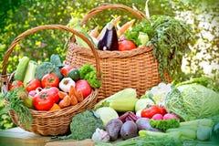 Fresh organic vegetables in wicker basket. On table Stock Image
