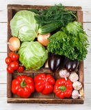 Fresh organic vegetables in wooden crate Royalty Free Stock Image