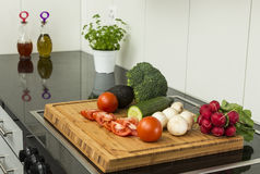 Fresh organic vegetables on a wooden cutting board Stock Photo