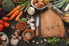 Fresh organic vegetables and wooden desk background Stock Image