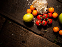 Fresh organic vegetables on a wooden table. With space for text. Royalty Free Stock Images