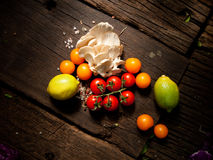 Fresh organic vegetables on a wooden table. Top down shot. Stock Photos