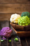 Fresh organic white and purple cauliflower, broccoli, romanesco Stock Image