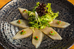 Fresh organic white tuna meat sliced at plate with salad Stock Image