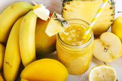 Fresh organic yellow smoothie Stock Photos
