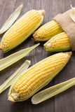 Fresh organic yellow sweet corn on wooden table Royalty Free Stock Photo