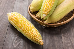 Fresh organic yellow sweet corn on wooden table Stock Images