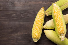 Fresh organic yellow sweet corn on wooden table. Top view Stock Photos