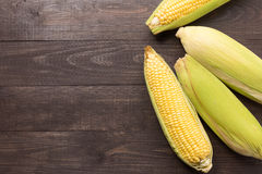 Fresh organic yellow sweet corn on wooden table. Top view Royalty Free Stock Image