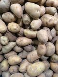 Fresh organic young potatoes sold on market Stock Images