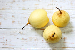 Fresh oriental pear on a white wood Royalty Free Stock Image
