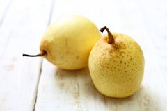 Fresh oriental pear on a white wood. Background Stock Photos