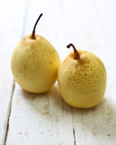 Fresh oriental pear on a white wood Stock Images