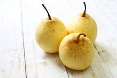 Fresh oriental pear on a white wood Stock Photos