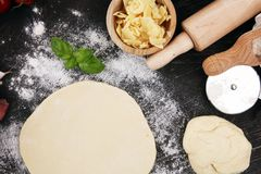 Fresh original Italian raw pizza preparation with fresh ingredie. Nts Stock Images
