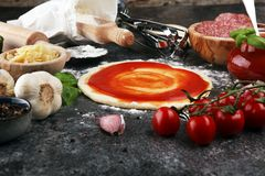 Fresh original Italian raw pizza preparation with fresh ingredie. Nts Royalty Free Stock Image