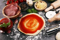Fresh original Italian raw pizza preparation with fresh ingredie. Nts Stock Photo