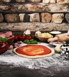 Fresh original Italian raw pizza preparation with fresh ingredie. Nts Stock Image
