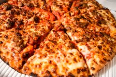 Fresh Baked Sausage Pizza Closeup. Fresh oven baked pizza in box closeup stock photography