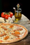 Fresh Oven Baked Pizza with ham, Sausage, All Cheese Royalty Free Stock Photo