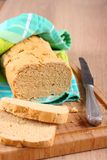 Fresh from the oven gluten free bread on a cutting board Royalty Free Stock Images