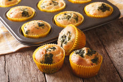 Fresh from the oven muffins with spinach and feta cheese close-u Royalty Free Stock Photo
